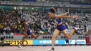 Dalilah Muhammad (left) set a world record when she beat Sydney McLaughlin (right) to the 400m world championship title in Doha.