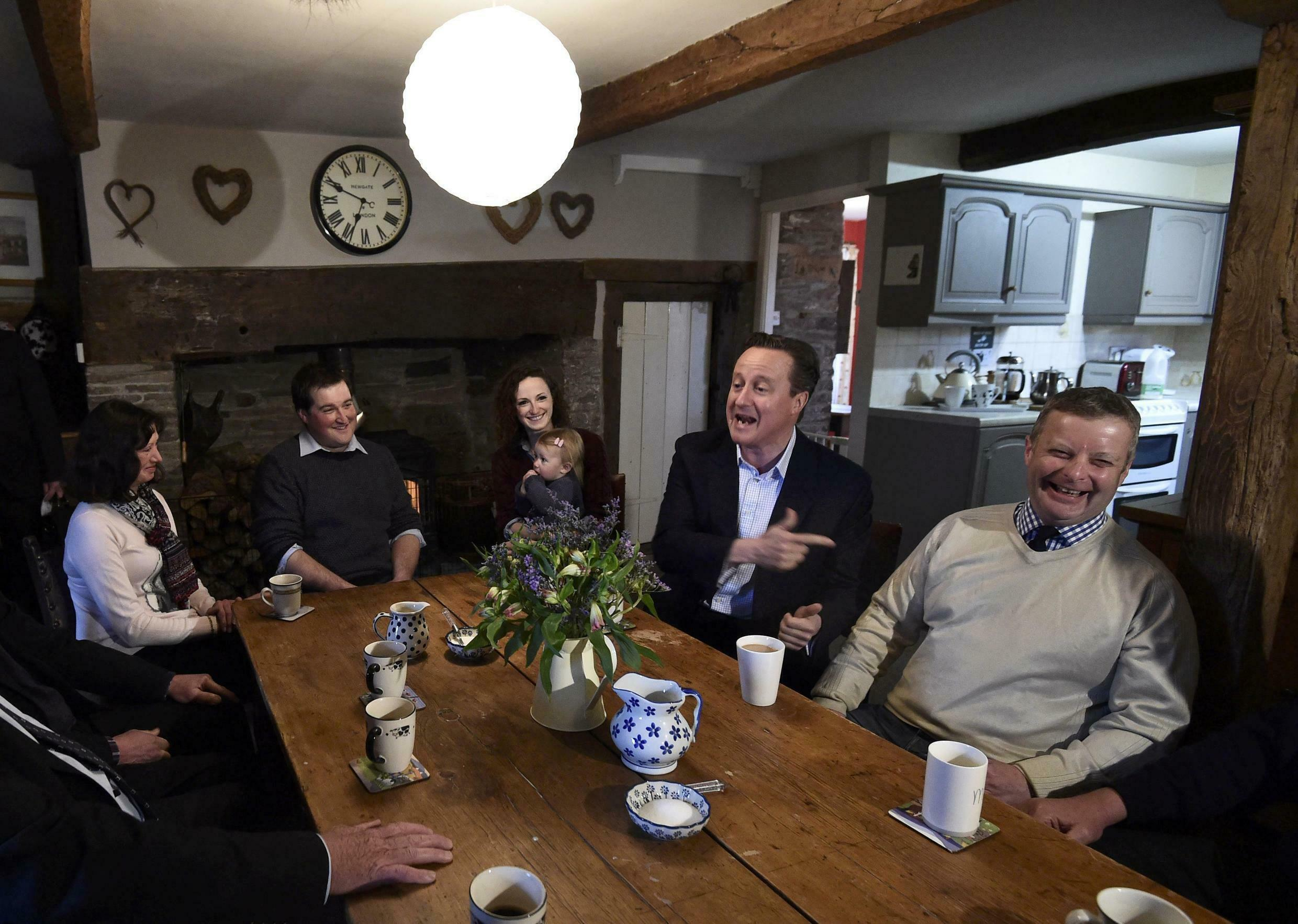 Britain's PM David Cameron speaks with local members of the farming community at Whole House Farm near Brecon in Wales.
