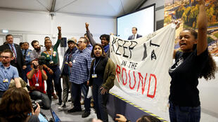 Environmental activists protest against fossil fuel during U.S. panel at the COP24 UN Climate Change Conference 2018 in Katowice, Poland December 10, 2018.
