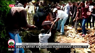 Ethiopian musician Hachalu Hundessa is buried in Ambo, Ethiopia, July 2, 2020, in this still image from a video.