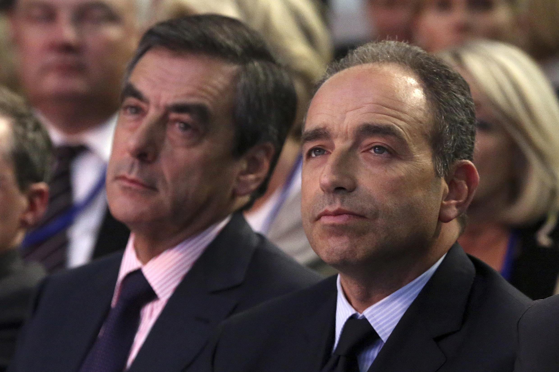 François Fillon (L) Jean-François Copé (R) still fighting it out