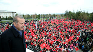 Turkish President Tayyip Erdogan addresses his supporters upon his arrival at Esenboga Airport in Ankara on April 17, 2017.