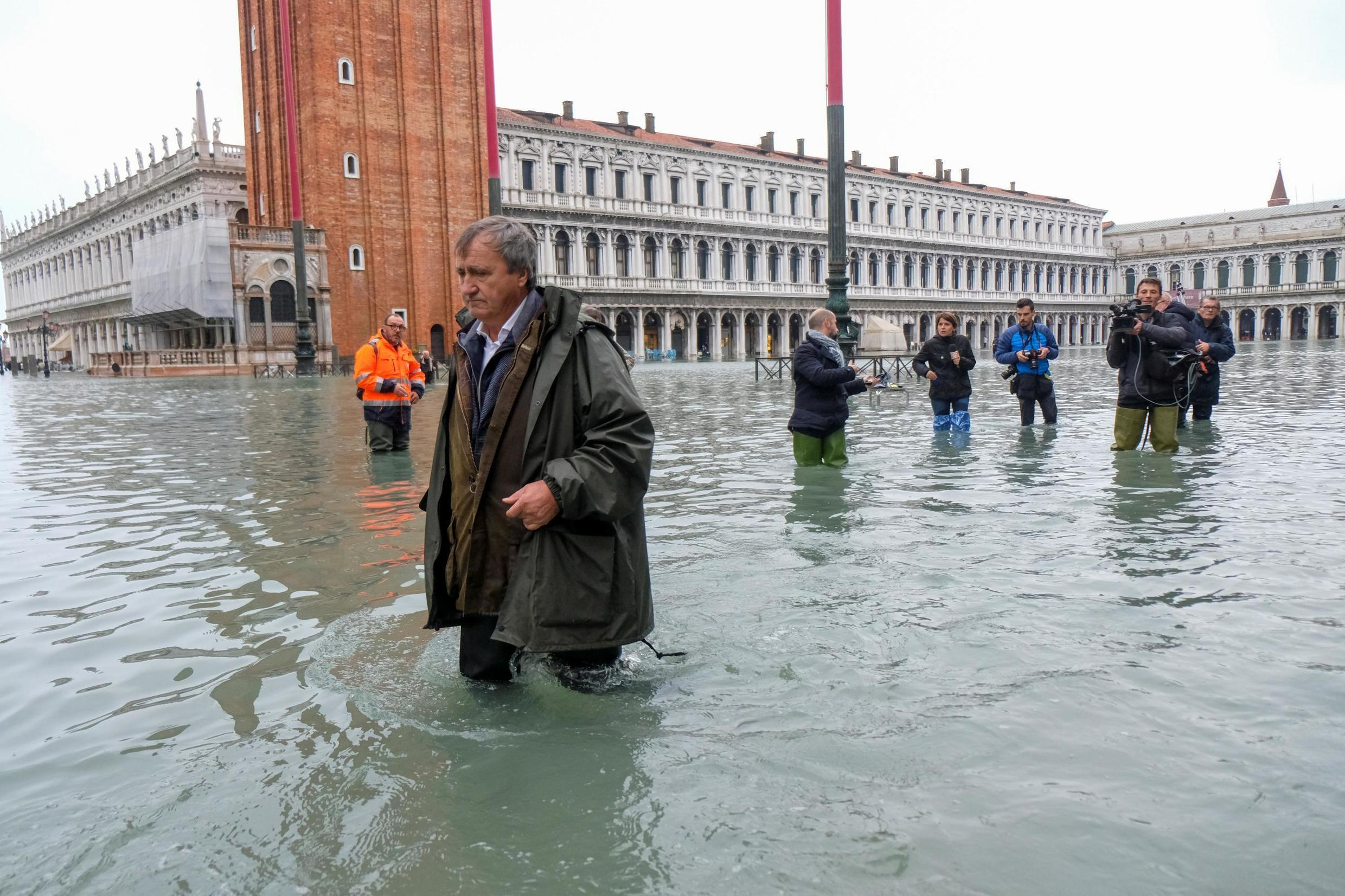 The Mayor of Venice Luigi Brugnaro walks on St Mark's Square during an exceptionally high water levels in Venice, Italy November 13, 2019.