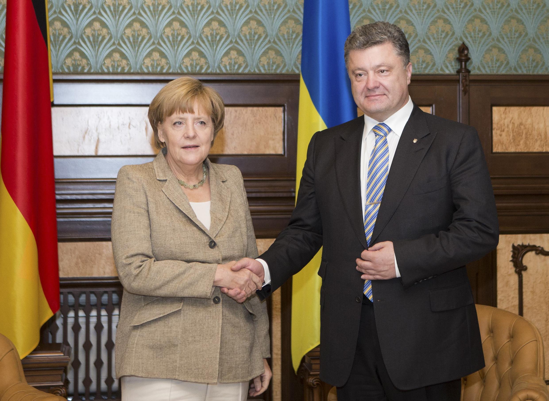 Ангела Меркель и Петр Порошенко на встрече в Киеве 23 августа 2014 года