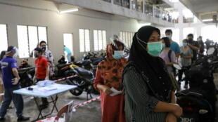 2021-07-12T070638Z_1100826941_RC2QIO9AV4QL_RTRMADP_3_HEALTH-CORONAVIRUS-MALAYSIA