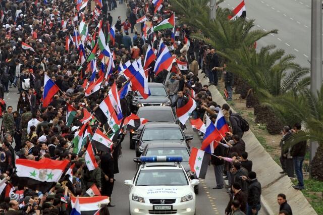 Wafuasi wa Bashara al Assad wakisheherekea ushindi wa jeshi dhdi ya waasi.