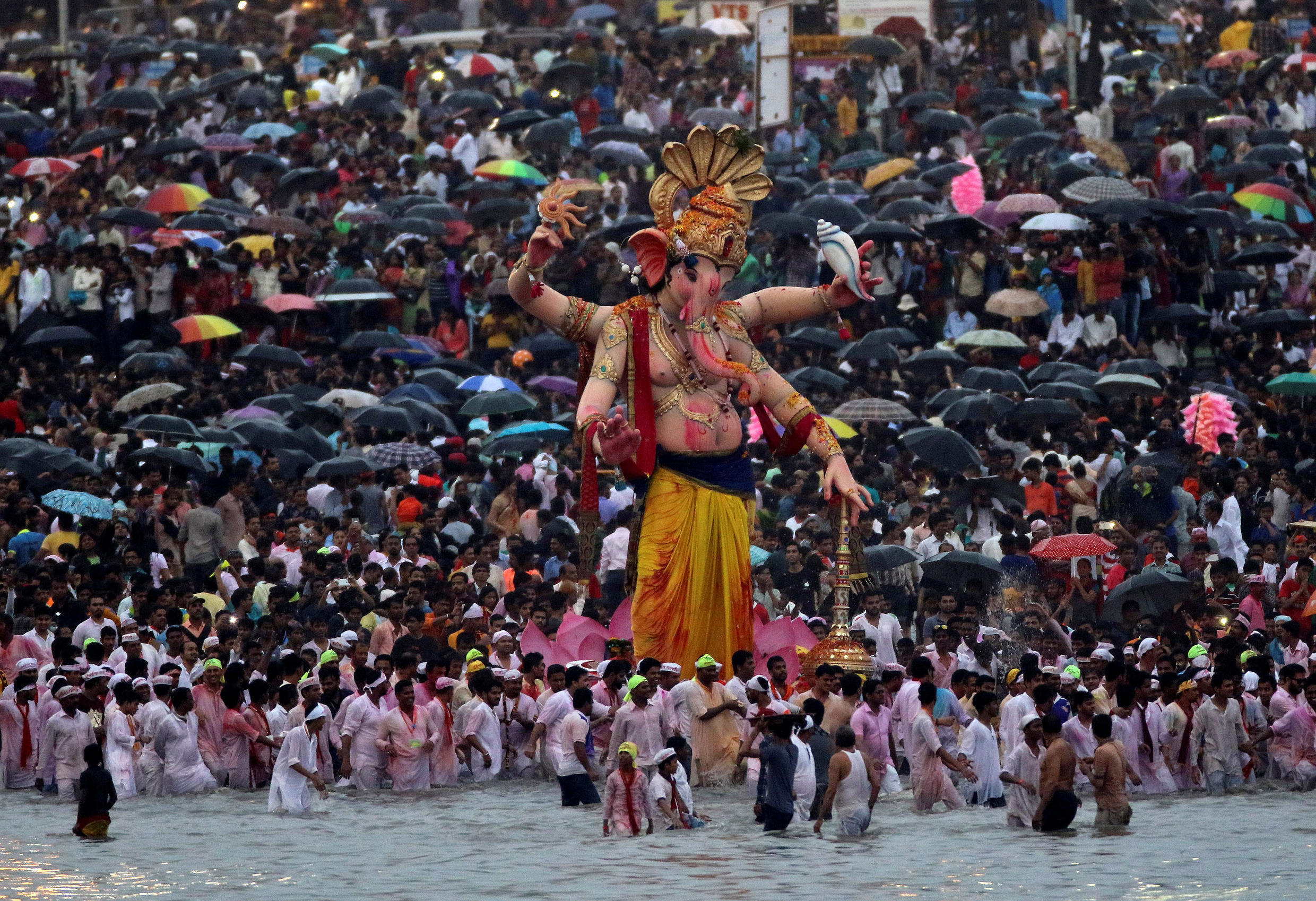 Devotees gather on the shores of the Arabian Sea in Mumbai to immerse idols of the Hindu god Ganesh