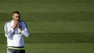 Real Madrid's Karim Benzema gestures during a training session at the team's training grounds outside Madrid.