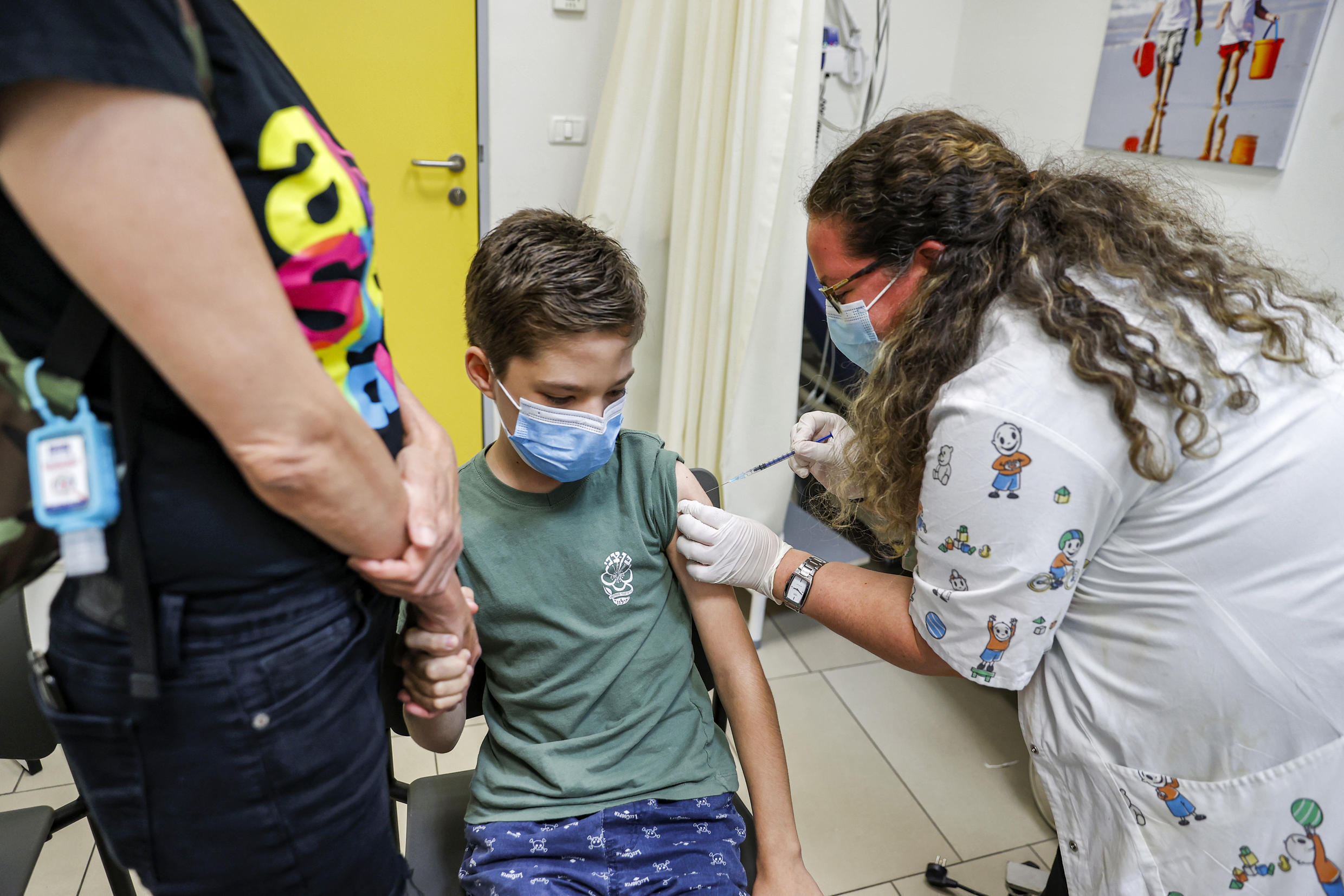 A boy receives a dose of the Pfizer/BioNTech Covid-19 vaccine in the Israeli city of Holon near Tel Aviv