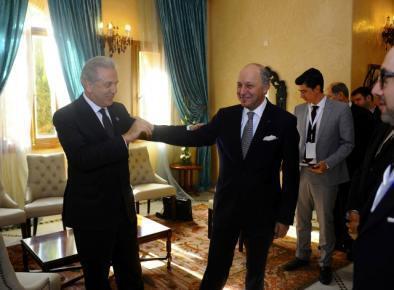Saudi Foreign Minister Saud al-Faisal bin Abdulaziz al-Saud (L) with Laurent Fabius after the meeting in Marrakesh