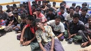 Rohingya Muslims fleeing violence.