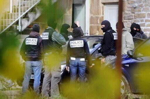 Investigators in Tarnac on 11 November 2008, as part of the investigation into sabotage of high-speed train lines..