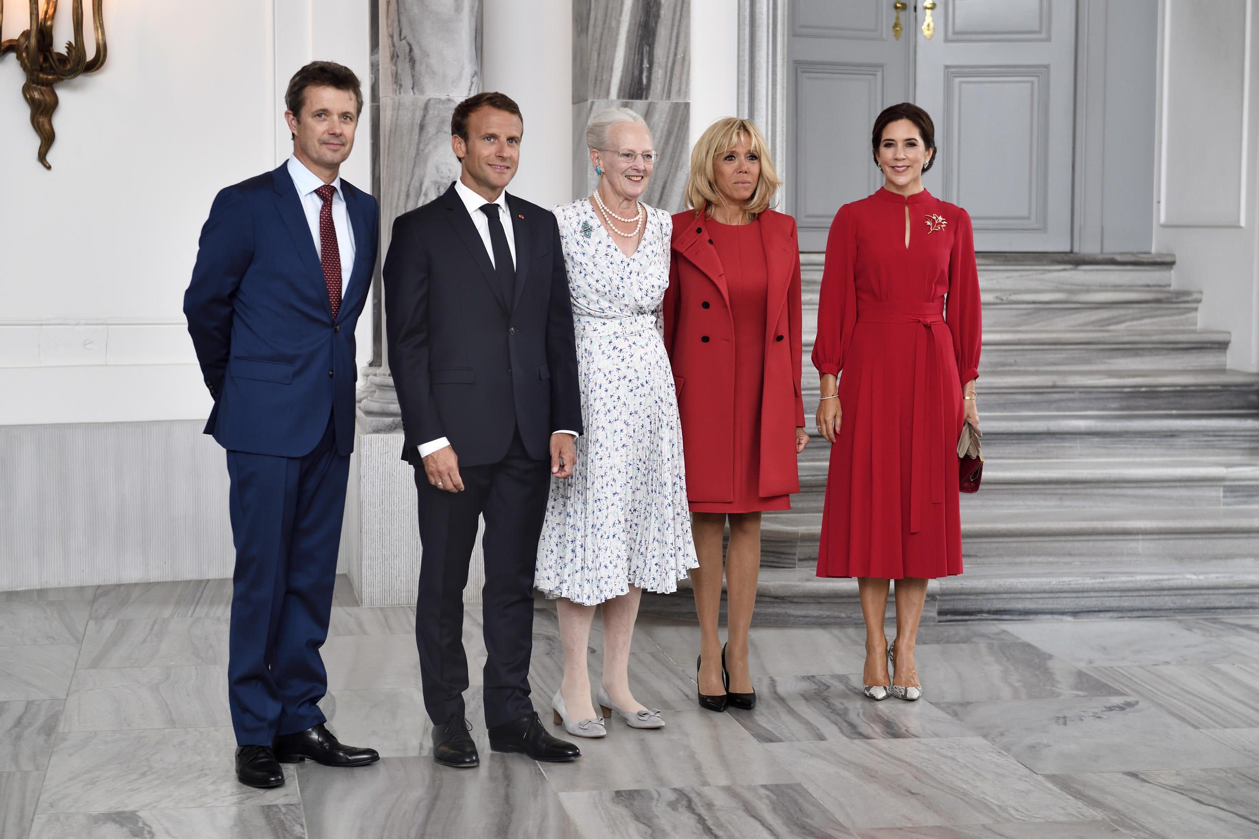 Queen Margrethe II of Denmark welcomes French President Emmanuel Macron and his wife Brigitte Macron at the Amalienborg Castle in central Copenhagen on August 28, 2018.