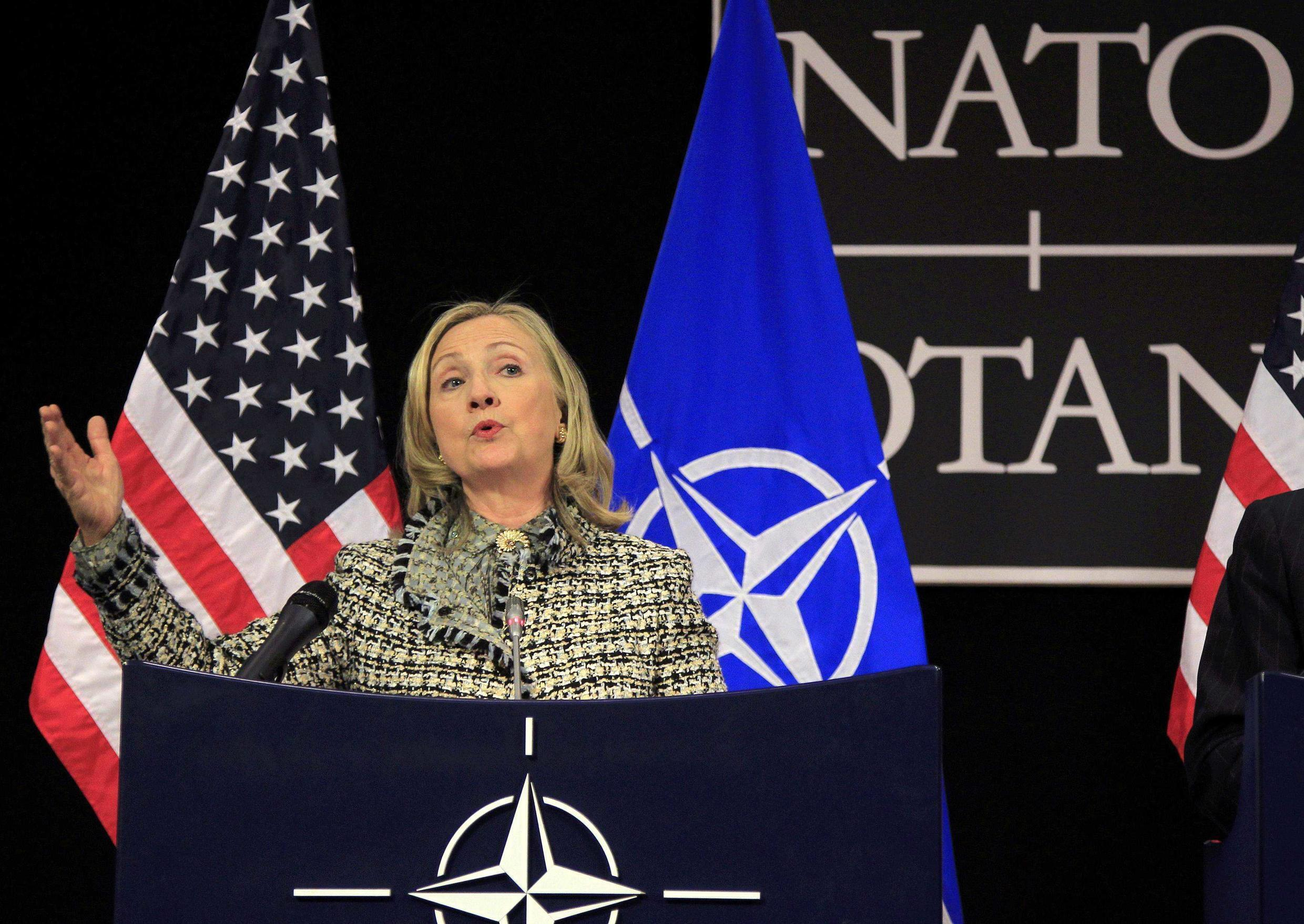 US Secretary of State Hillary Clinton speaks at a news conference at the Alliance headquarters in Brussels