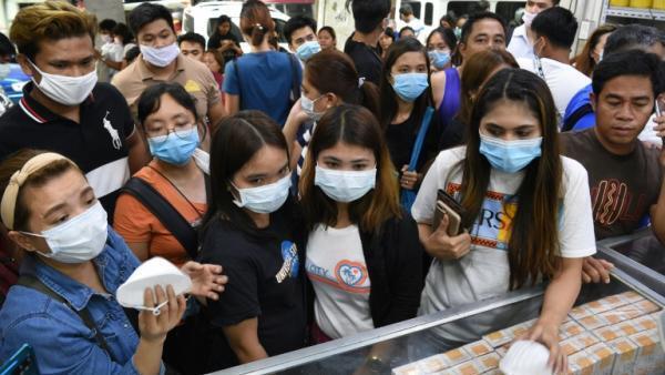 Les habitants de Manille se sont rués sur les masques mis en vente.