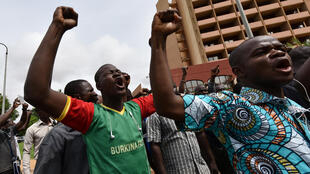 Protesters chant slogans during a demonstration outside the Hotel Liaco in Ougadougou on 20 September, 2015.