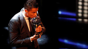 Real Madrid's Cristiano Ronaldo celebrates after winning The Best FIFA Men's Player Award Action
