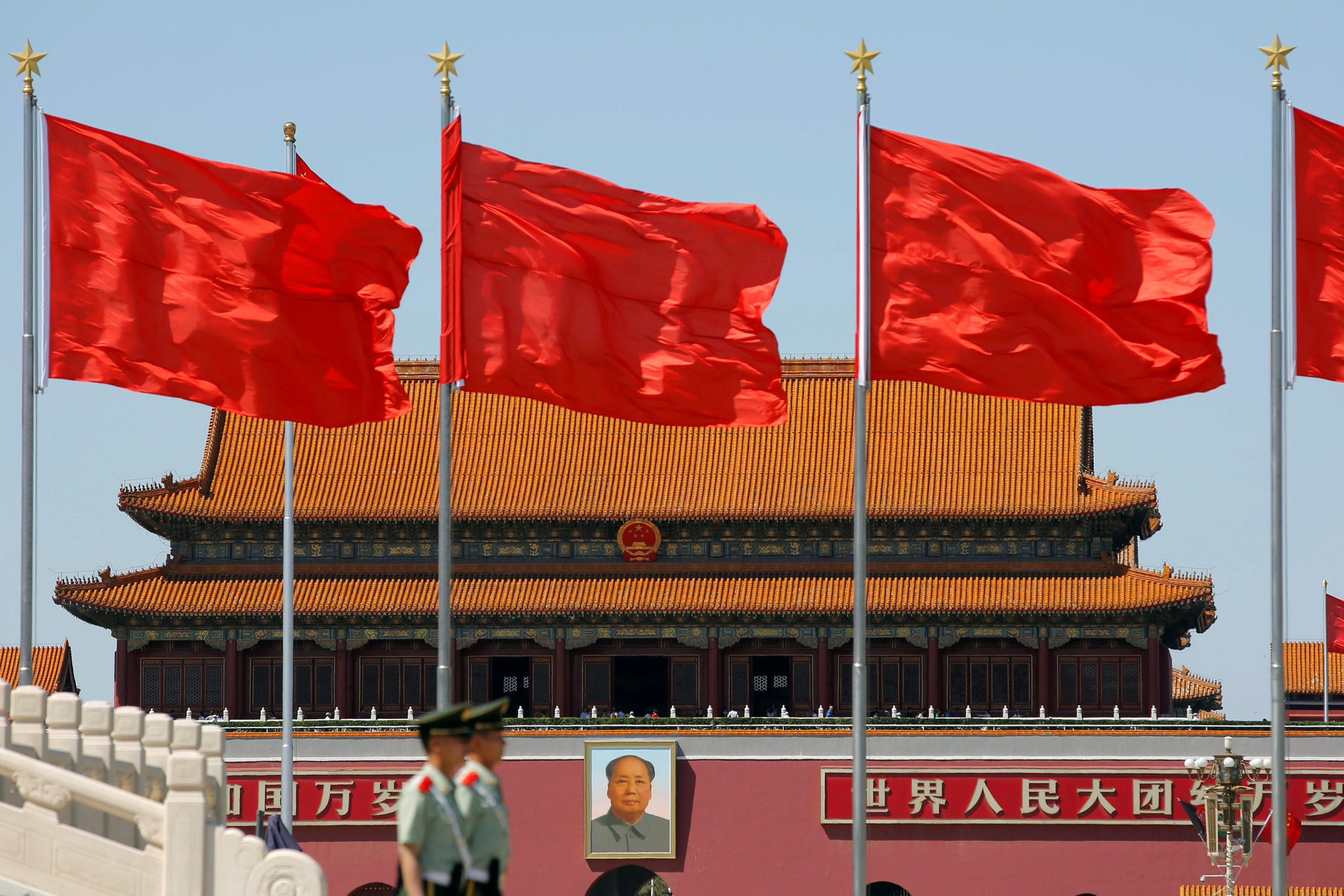 Paramilitary solders stand guard at Tiananmen Square where the portrait of late Chinese chairman Mao Zedong is seen, on the 50th anniversary of the start of the Cultural Revolution in Beijing, China, May 16, 2016.