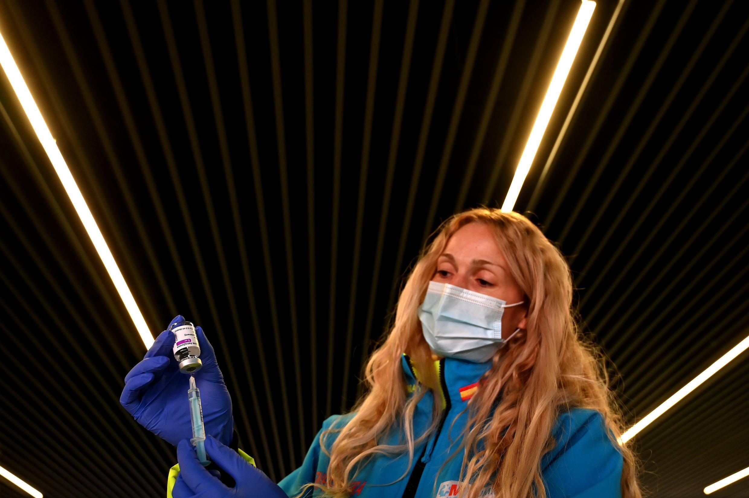 A health worker prepares a dose of the AstraZeneca vaccine in Madrid. Europe has received far fewer doses of the jab than promised