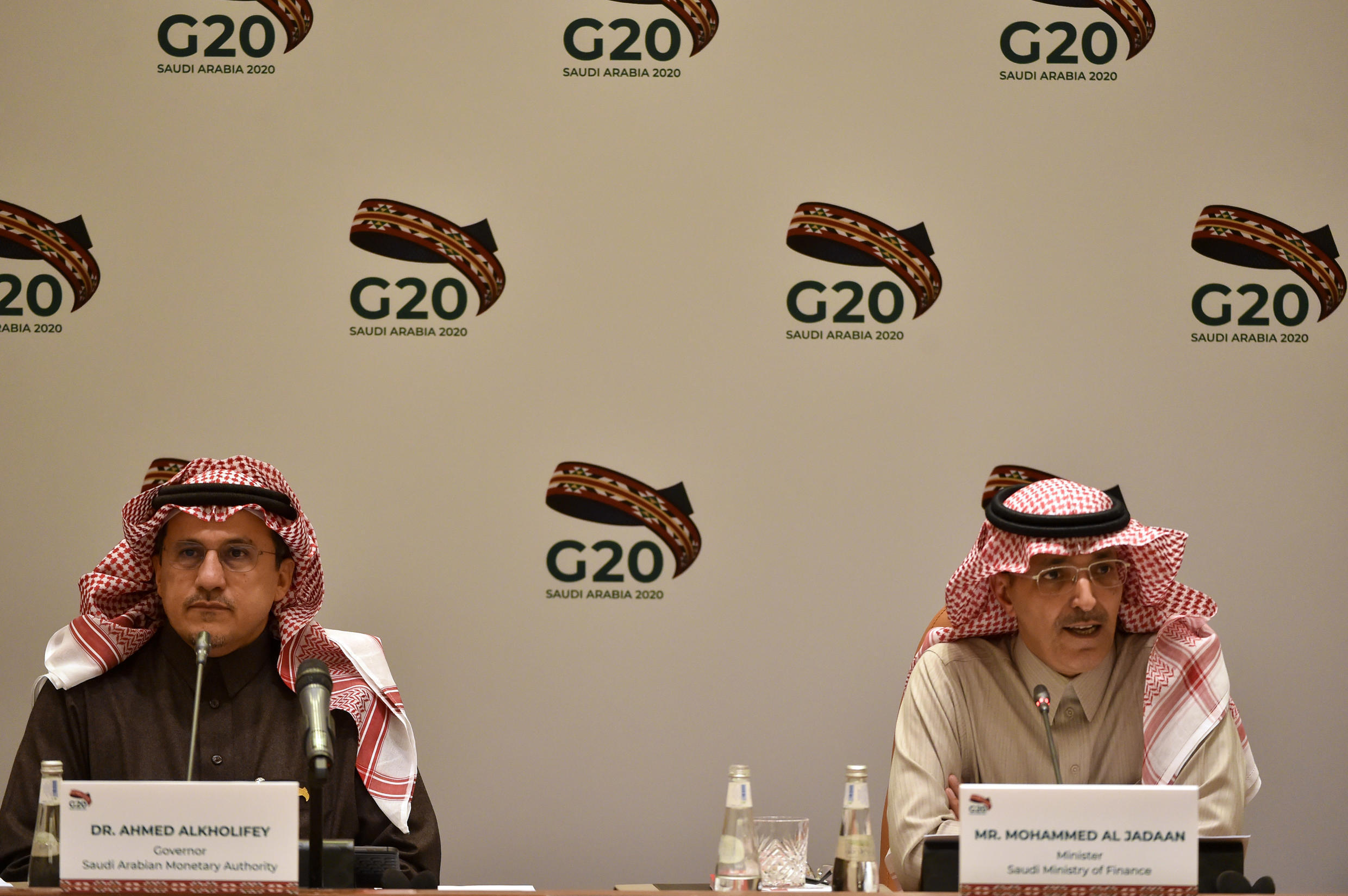 Saudi Arabia is the host of the virtual G20 talks, chaired by Saudi Finance Minister Mohammed al-Jadaan (R) and central bank governor Ahmed al-Kholifey