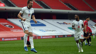 La joie de l'attaquant anglais Harry Kane, après avoir ouvert le score contre l'Albanie, lors de leur match match de qualification pour le Mondial 2022, le 28 mars 2021 à Tirana