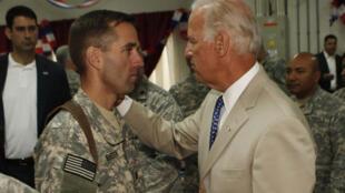 Then vice president Joe Biden visits his son Beau on duty in Iraq on July 4, 2009