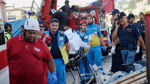 Rescue workers in Genoa