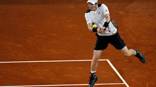 Defending champion Andy Murray in action against Tomas Berdych in the quarter final of Madrid Masters.