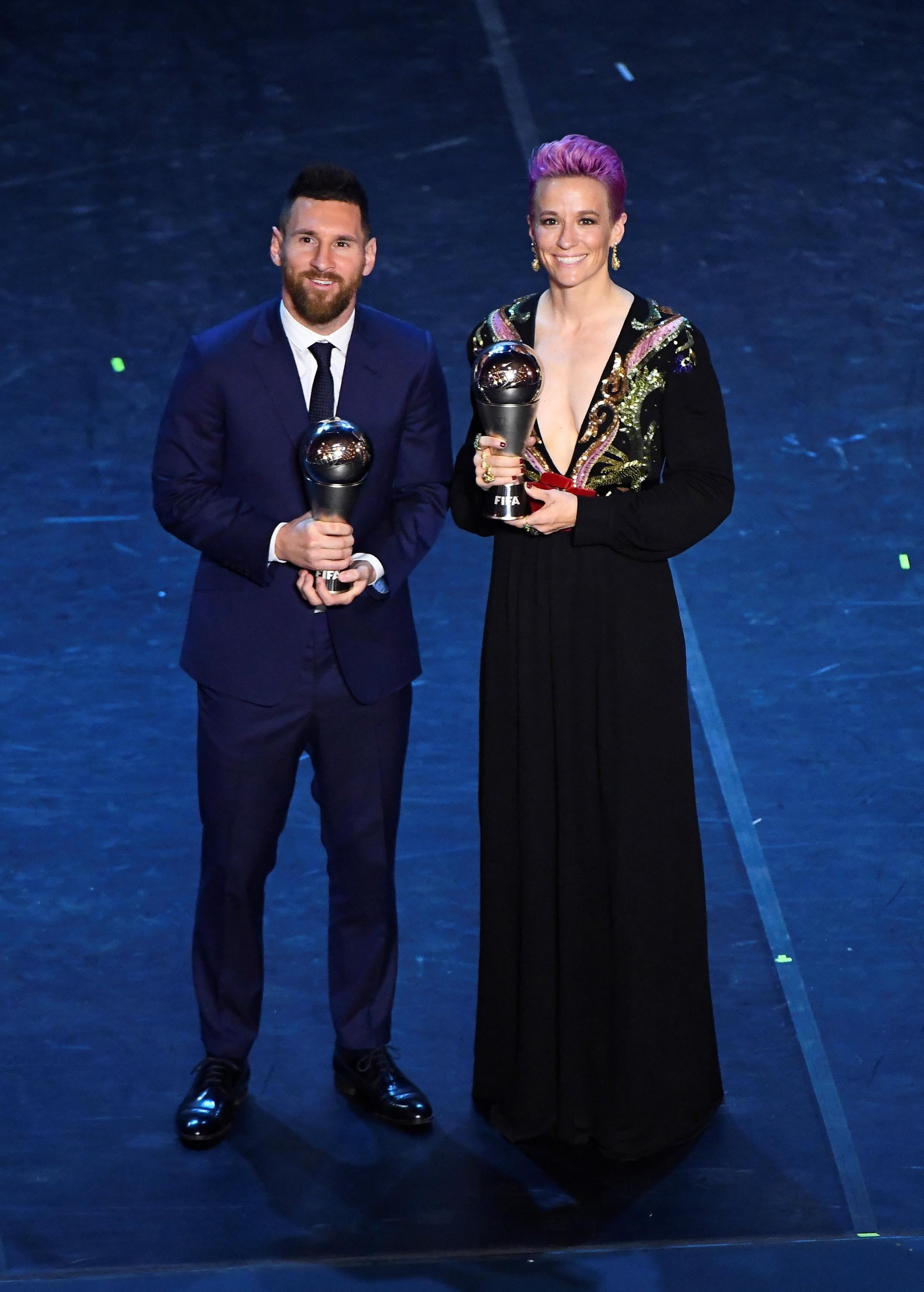 Lionel Messi and Megan Rapinoe pose with their FIFA Player of the Year awards, Milan, Italy, September 23, 2019.