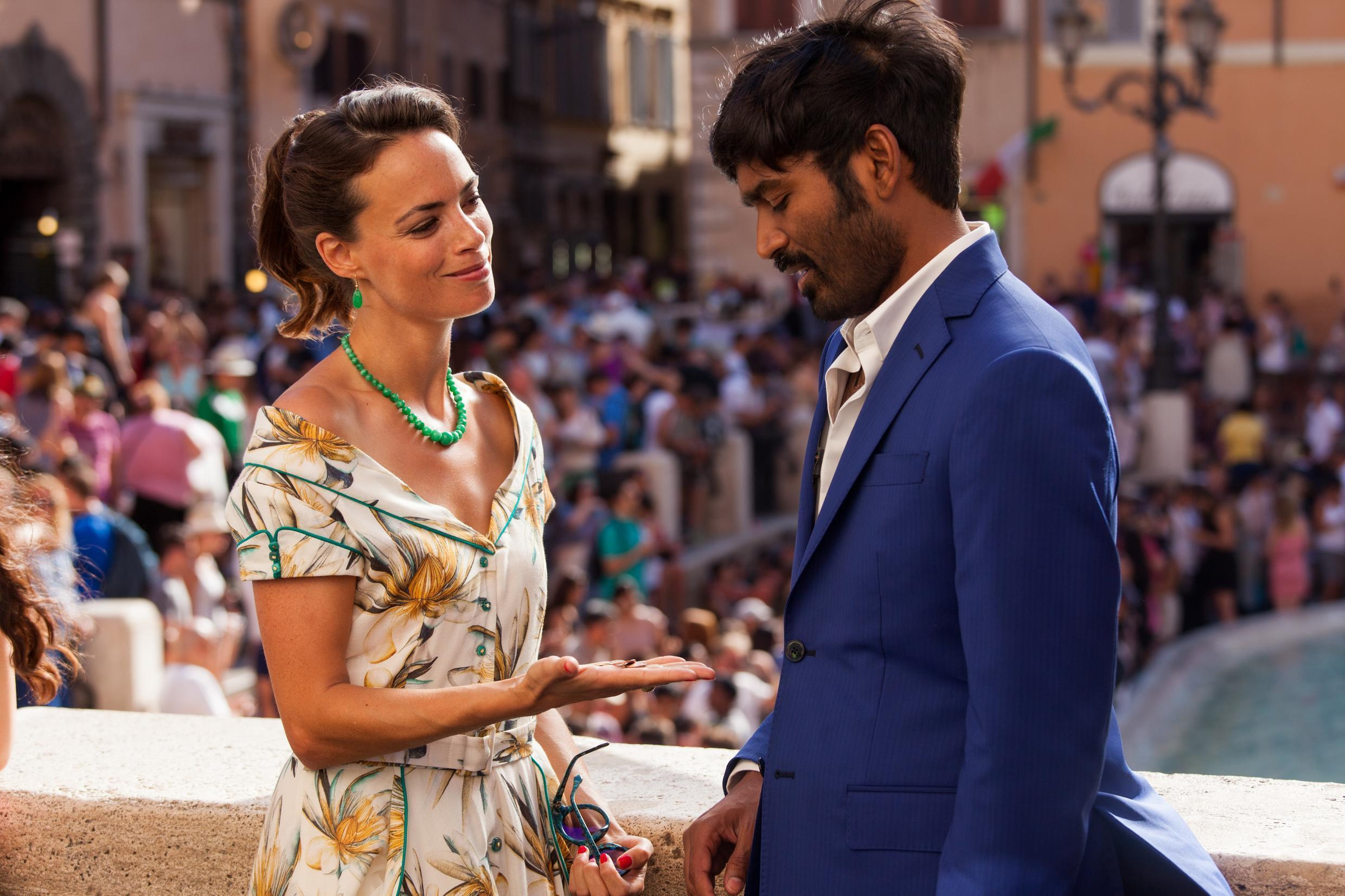 Bérénice Béjo and Dhanush make a wish in Rome in The Fakir's Extraordinary Journey directed by Ken Scott, May 2019