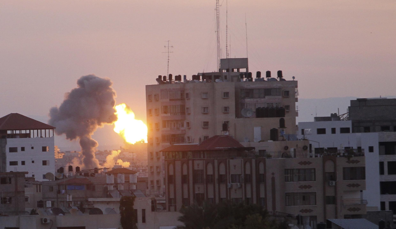 An Israeli shell hits Gaza City on Friday
