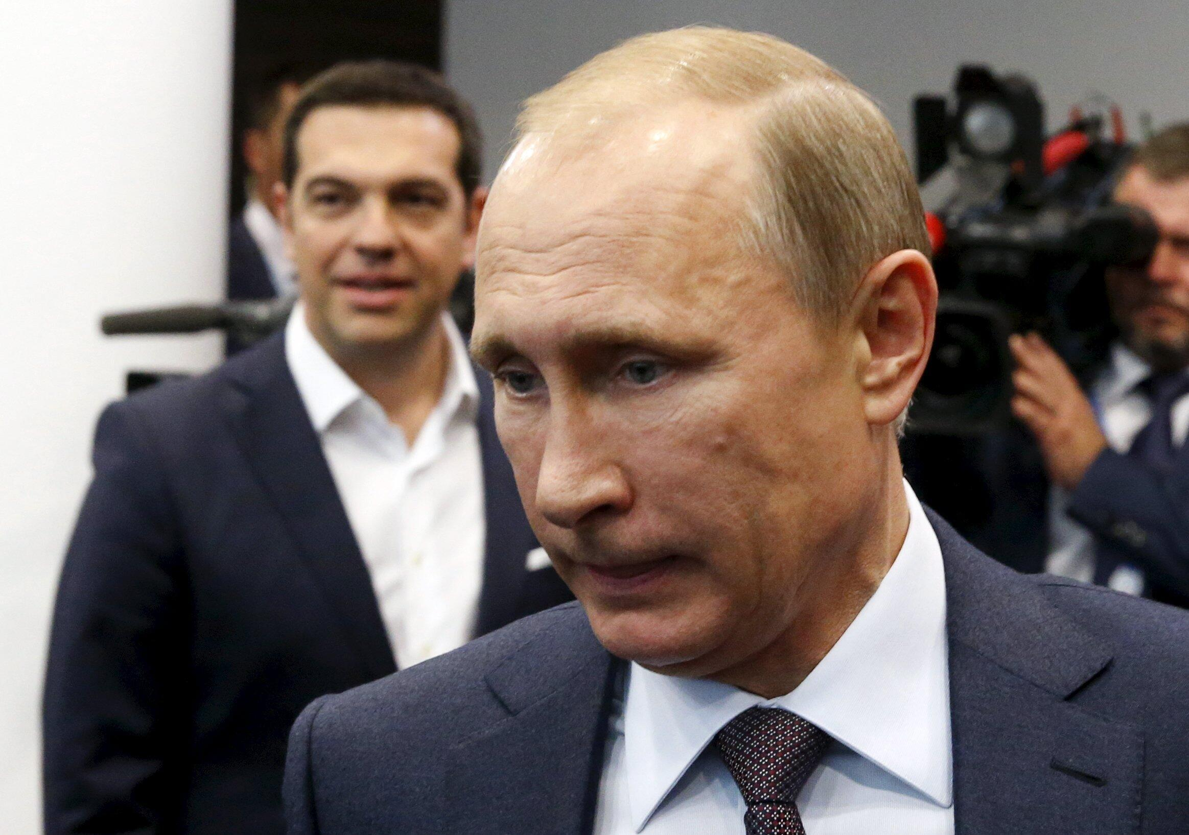 Russian President Vladimir Putin (front) and Greek Prime Minister Alexis Tsipras arrive for a meeting at the St. Petersburg International Economic Forum 2015 (SPIEF 2015) in St. Petersburg, Russia, June 19, 2015