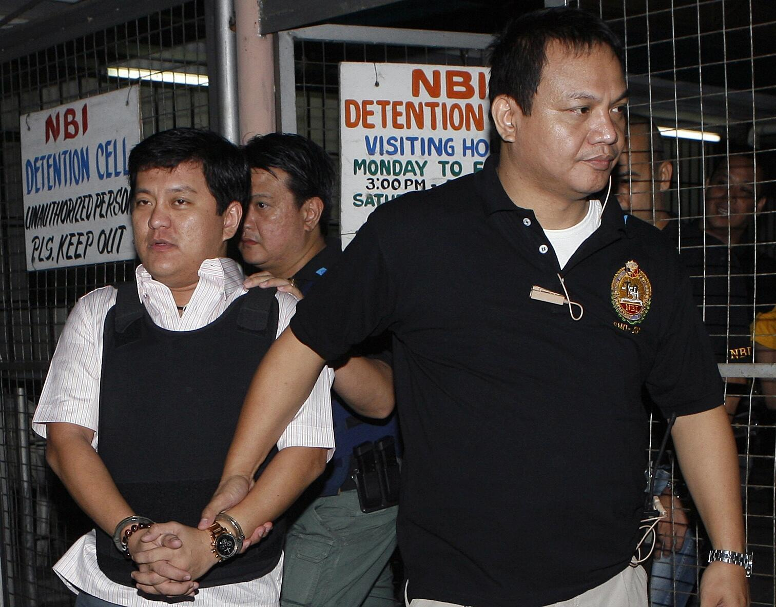 Andal Ampatuan Jnr is escorted to his trial in Manila