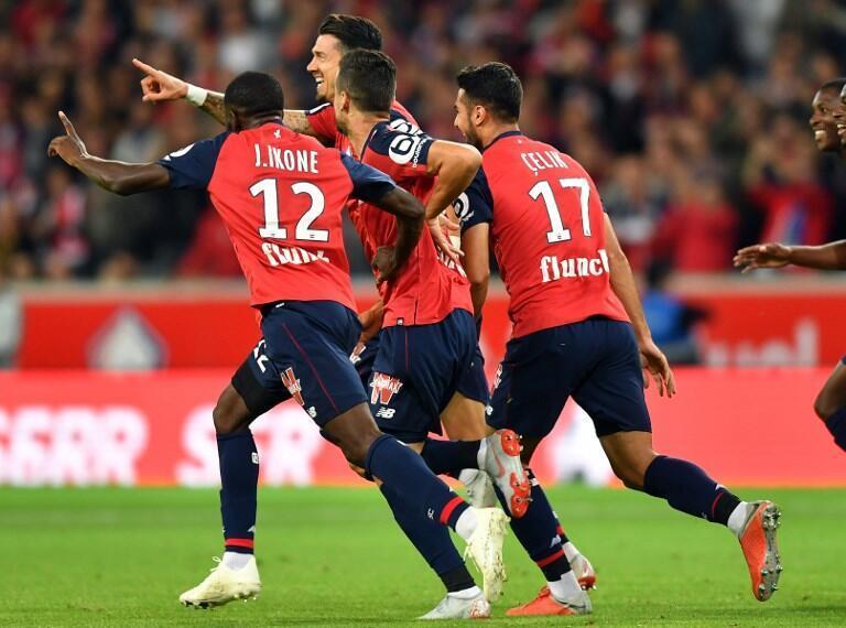 Os jogadores do Lille arrecadaram o empate a uma bola frente ao Reims nos últimos segundos do jogo com uma grande penalidade.