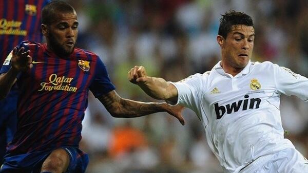 Danny Alves wa Barcelona akichuana na Christian Ronaldo wa R. Madrid