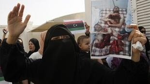 A protester demonstrates in solidarity with the anti-government protests in Libya in front of the Libyan consulate in Dubai