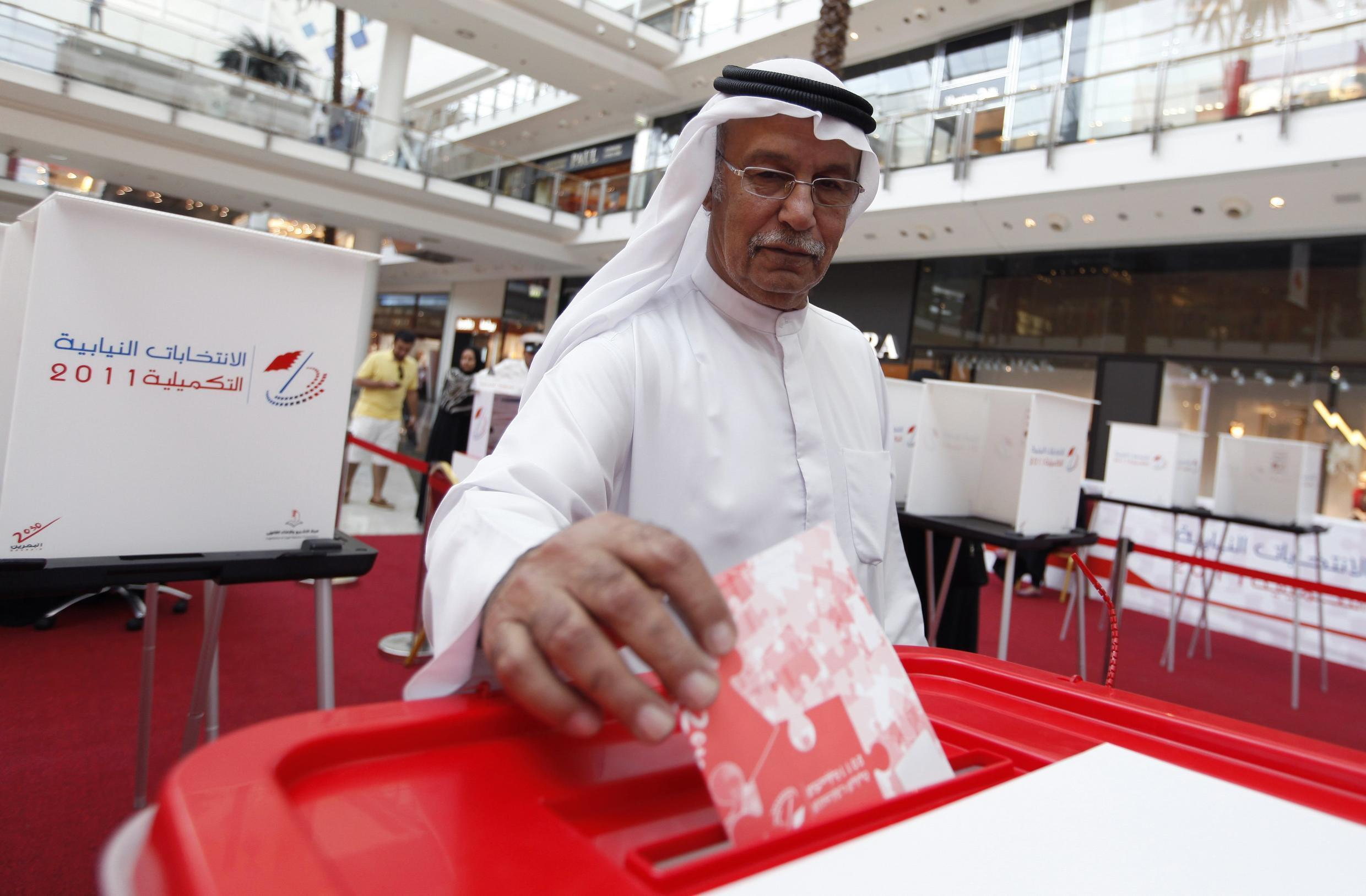 A Bahraini votes in Saturday's election, boycotted by the opposition