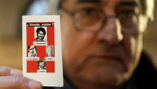 Bernard Alexandre Chanfreau, shows a photo of his brother Alphonse Rene Chanfreau and the three others victims