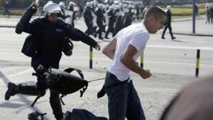 An anti-gay protester runs from riot police in Belgrade October 10, 2010.