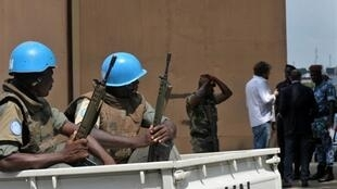 UN soldiers guard the Independent Electoral Commission building in Cote d'Ivoire on 1 December 2010.