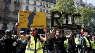 Protesters wearing yellow vests attend a demonstration during the traditional May Day labour day in Paris Protesters wearing yellow vests attend a demonstration during the traditional May Day labour day in Paris, France, May 1, 2019.
