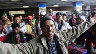 A Bangladeshi from Libya chants anti-government slogans at Dhaka airport where relatives protested over evacuation failures