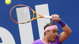 Tough day: Rafael Nadal returns the ball to Ilya Ivashka