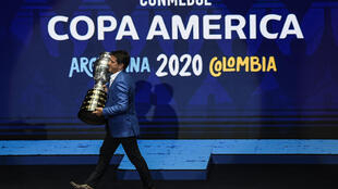 Former Brazil footballer Juninho Paulista presented the Copa America trophy at the draw ceremony in December 2019