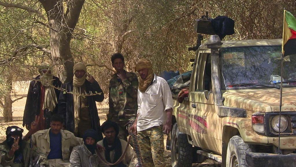 Wapiganaji wa MNLA wakipigwa picha karibu na mji wa Tabankort, nchini Mali. MNLA ni moja ya makundfi yanayounda CMA. Febrari 13 mwaka 2015.