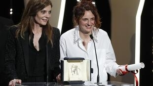 Italian director Alice Rohrwacher (R) won the award for Best Screenplay for 'Happy as Lazzaro' at Cannes Film Festival, May 2018