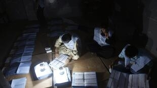 Afghan official count votes in a polling booth in Kabul, after parliamentary polls on September 18 2010.