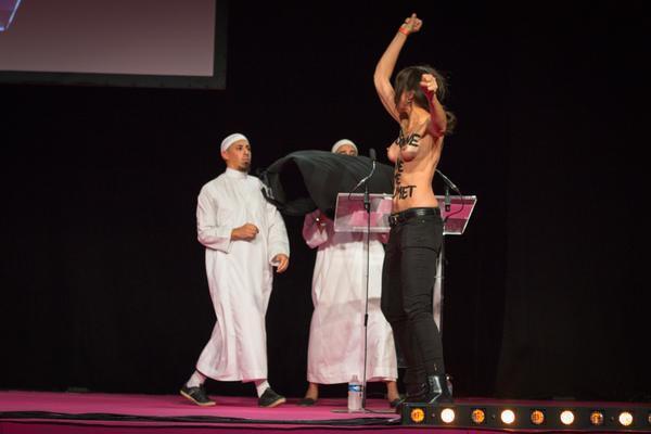 Femen activists burst onto the stage at a Muslim women's fair in Pontoise, near Paris, on Saturday