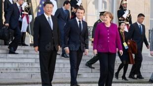法國巴黎-—-年-月-日:馬克龍、安格拉·默克爾和習近平-185928341