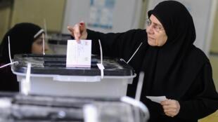 Segundo dia de referendo no Egito sobre a Constituição conta com a presença em massa das mulheres.